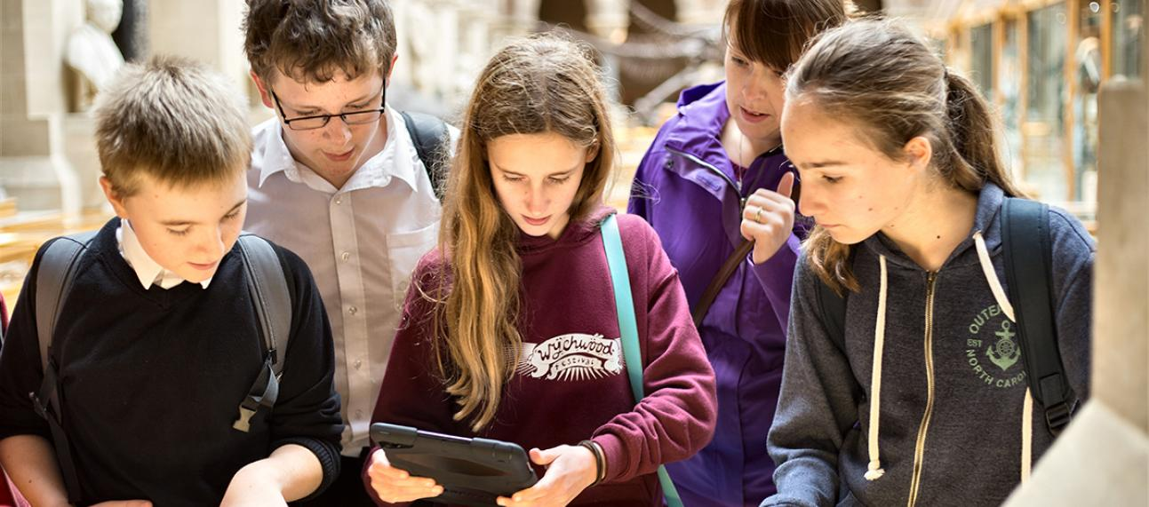 Students using a tablet at the Museum
