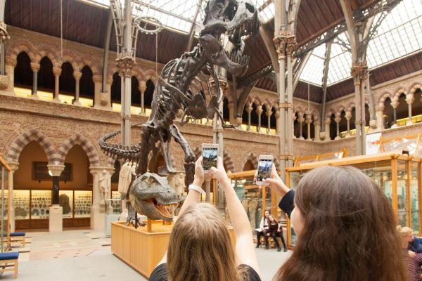 Students filming the T rex