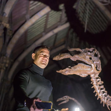 Steve Backshall in torchlight investigating the Mystery at the Museum